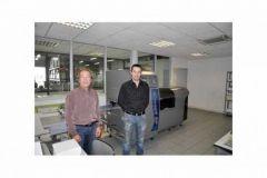 Jean Allais et François Nicot, devant une presse numérique de production MGI DP60