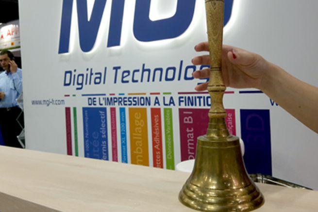 La cloche de MGI résonne à chaque signature d'une nouvelle commande de machines sur les salons.