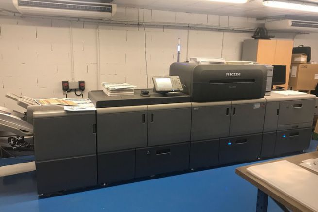 Ricoh Pro C9100 installée chez l'imprimeur en ligne Comoprint.
